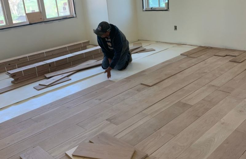 gennett installer laying flooring