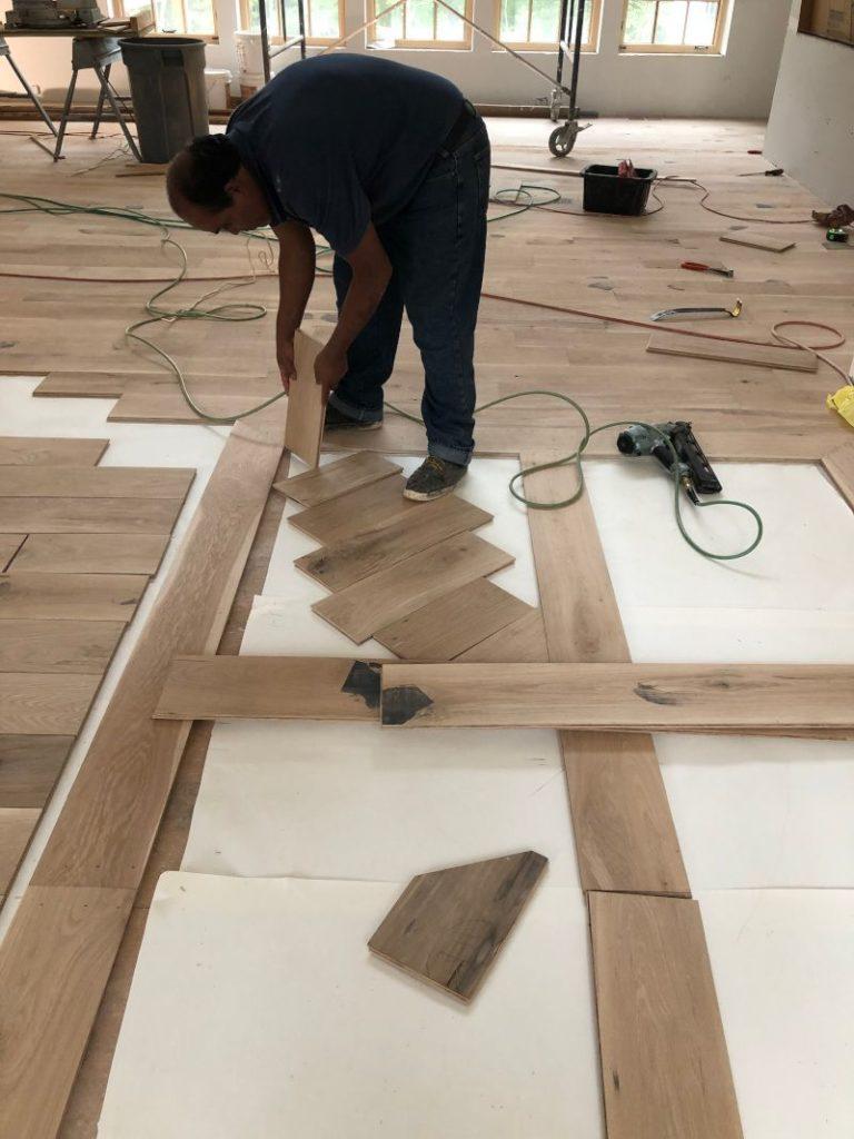 gennett installer laying flooring on a bias